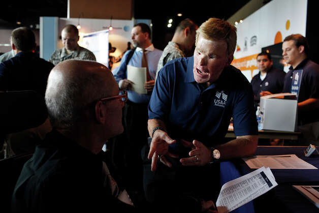 USAA recruiter Todd Nelson, MSG, USA, Ret., talks with potential employees including Army veteran Dr. Mariano Velez, left, during the RecruitMilitary Veteran job fair at the AT&T Center in San Antonio on Thursday, Sept. 13, 2012. In addition to looking for employment, Velez is gathering information for members of the National Spinal Cord Injury Association, of which he is the executive director for The Alamo of San Antonio Chapter. Photo: Lisa Krantz, San Antonio Express-News / San Antonio Express-News