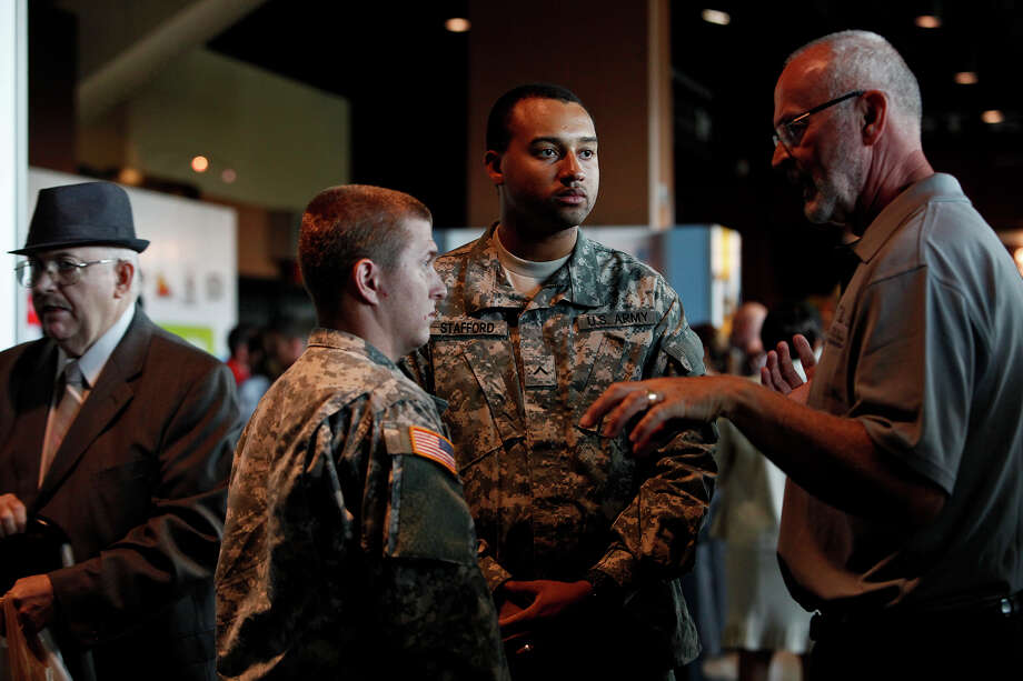 Private Cory Nicol, left, and Private Jonathan Stafford, center, both in the National Guard, attend the Recruit Military Veteran job fair last year. Manufacturing and veterans may be the perfect match. Photo: Lisa Krantz, San Antonio Express-News / San Antonio Express-News