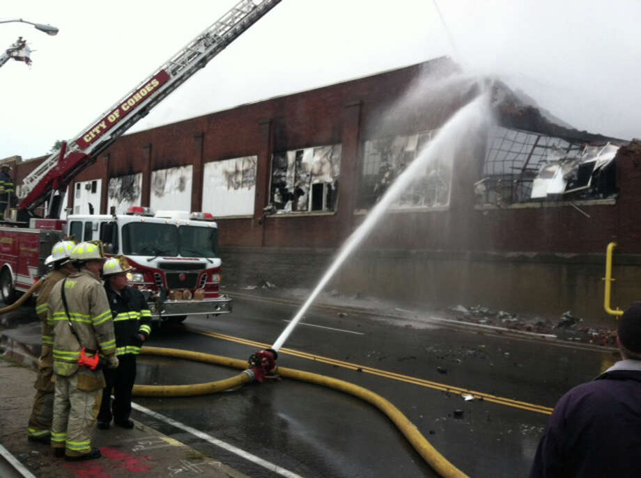 Firefighters work to control the fire Thursday morning at a warehouse in Cohoes. (Skip Dickstein / Times Union)