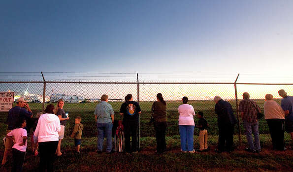 People line up as they wait for the space shuttle Endeavour to leave Ellington Field Thursday, Sept. 20, 2012, in Houston. Photo: Cody Duty, Houston Chronicle / © 2012 Houston Chronicle