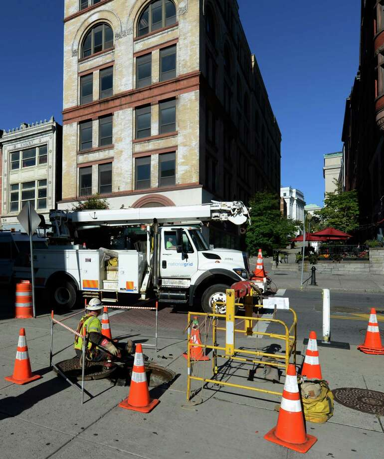 National Grid crews work Thursday at the site of an explosion Wednesday  under North Pearl Street near Stuben Street in Albany.  (Skip Dickstein / Times Union) Photo: Skip Dickstein