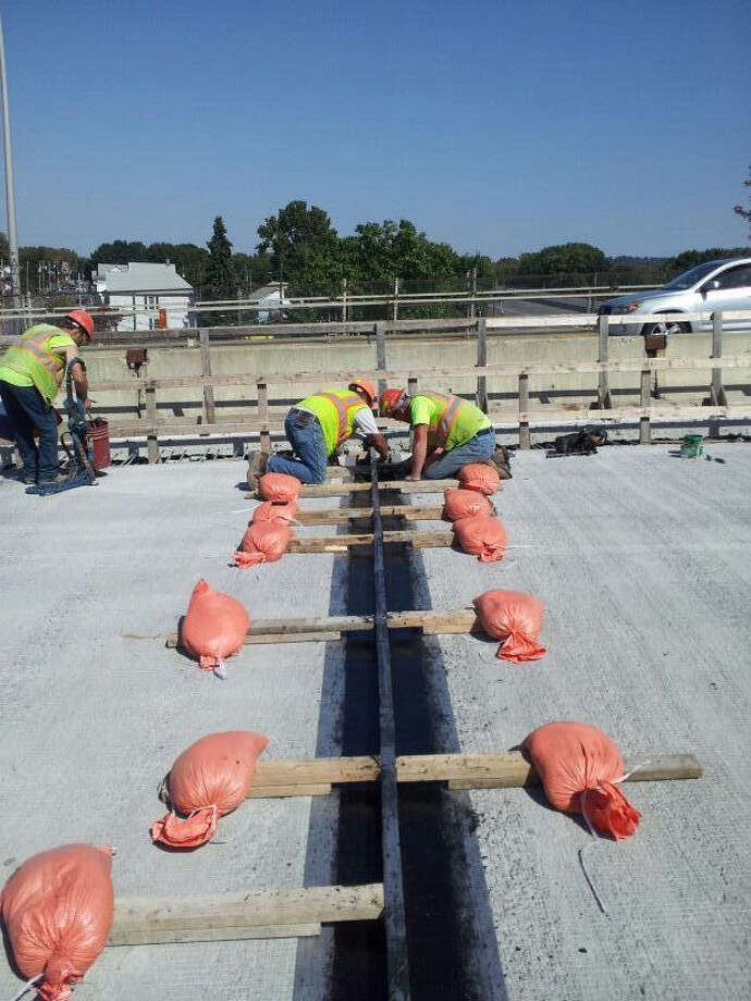 Workers on the Congress Street bridge between Troy and Watervliet on Monday, Sept. 17, 2012. The contract workers are completing the deck replacement project, funded by NY Works. (Photos provided by state Department of Transportation)