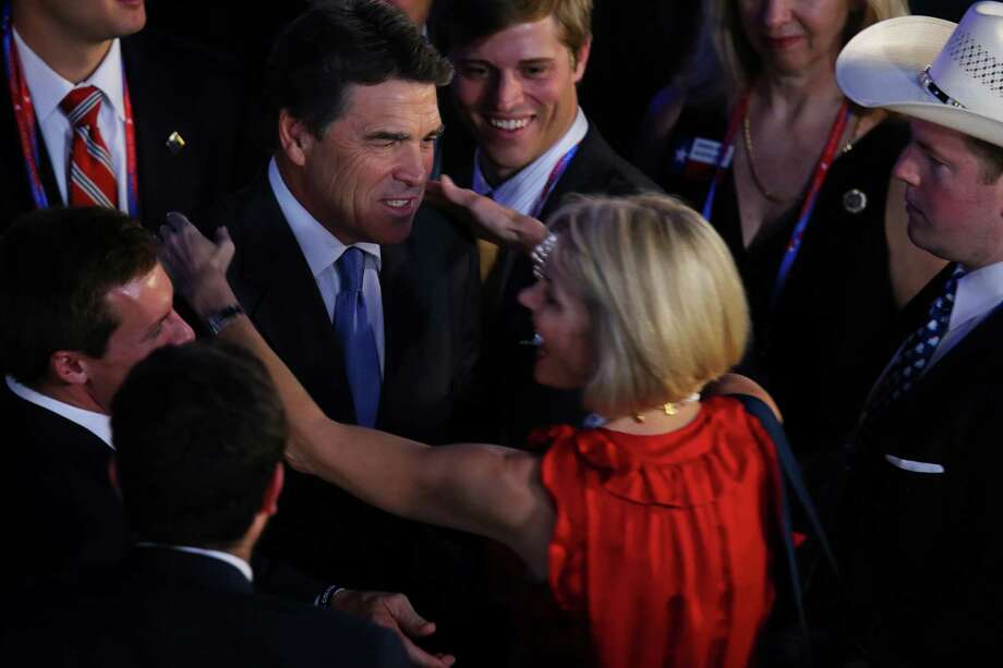 TAMPA, FL - AUGUST 30:  Attendees greet Texas Gov. Rick Perry during the final day of the Republican National Convention at the Tampa Bay Times Forum on August 30, 2012 in Tampa, Florida. Former Massachusetts Gov. Mitt Romney was nominated as the Republican presidential candidate during the RNC which will conclude today. Photo: Joe Raedle, Getty Images / 2012 Getty Images