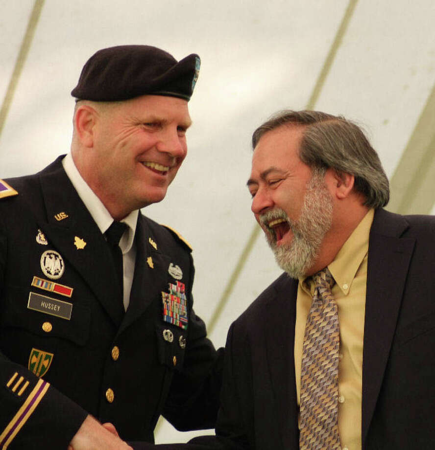 Col. John Hussey, left, shares a light moment with Sgt. Ernest F. Martinez of Danbury on Memorial Day in New Windsor, N.Y. After a 44-year wait, Martinez was awarded his Purple Heart and Silver Star medals from the Vietnam War at a special ceremony. Photo credit: Donna Flood Photo: Contributed Photo/ Donna Flood