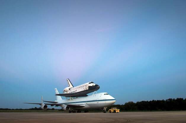 The US Space shuttle Endeavour is seen atop NASA's Shuttle Carrier Aircraft, or SCA, at the Shuttle Landing Facility in the early morning hours at NASA's Kennedy Space Center on Tuesday, September 18, 2012 in Cape Canaveral, Florida. The SCA, a modified 747 jetliner, will fly Endeavour to Los Angeles where it will be placed on public display at the California Science Center. This is the final ferry flight scheduled in the Space Shuttle Program era. Photo: BILL INGALLS, AFP/Getty Images / (NASA/Bill Ingalls)
