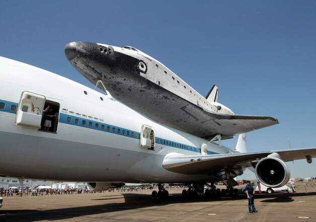 Space Shuttle Endeavour rests atop NASA's 747 Shuttle Carrier Aircraft at Ellington Field in Houston on Wednesday morning September 19, 2012. Endeavour will spend the night in Houston before continuing its journey from the Kennedy Space Center in Florida to the California Science Center in Los Angeles where it will be on permanent display. Photo: Kevin M. Cox, AP / The Galveston County Daily News