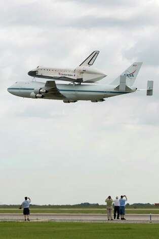 The space shuttle Endeavour, carried atop NASA's 747 Shuttle Carrier Aircraft, makes a low pass over Ellington Field during a flyover on Wednesday, Sept. 19, 2012, in Houston. Endeavour stopped in Houston on its way from the Kennedy Space Center to the California Science Center in Los Angeles, where it will be placed on permanent display. Photo: Smiley N. Pool, AP / Pool Houston Chronicle
