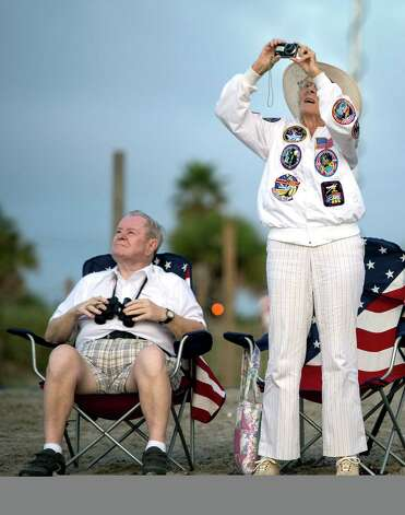 In this handout provided by NASA, Jorgen and Ruth Sabinsky watch as NASA's Shuttle Carrier Aircraft, or SCA, with the space shuttle Endeavour mated on top (top) flies over Cocoa Beach Pier on September 19, 2012 in Cocoa Beach, Florida. The SCA, a modified 747 jetliner, will fly Endeavour to Los Angeles where it will be placed on public display at the California Science Center. This is the final ferry flight scheduled in the Space Shuttle Program era. Photo: Bill Ingalls/NASA, Getty Images / 2012 NASA