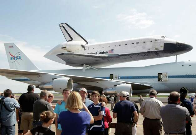 A large crowd takes photographs of the Space Shuttle Endeavour sitting atop NASA's 747 Shuttle Carrier Aircraft at Ellington Field in Houston on Wednesday, Sept. 19, 2012. Endeavour will spend the night in Houston before continuing its journey from the Kennedy Space Center in Florida to the California Science Center in Los Angeles where it will be on permanent display.  Photo: Kevin M. Cox, AP / The Galveston County Daily News