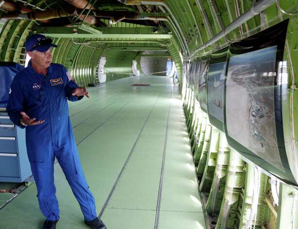 Flight engineer Larry Larose gives a tour inside NASA's 747 Shuttle Carrier Aircraft after it landed with Space Shuttle Endeavour at Ellington Field in Houston on Wednesday, Sept. 19, 2012. Endeavour will spend the night in Houston before continuing its journey from the Kennedy Space Center in Florida to the California Science Center in Los Angeles where it will be on permanent display. Photo: Kevin M. Cox, AP / The Galveston County Daily News