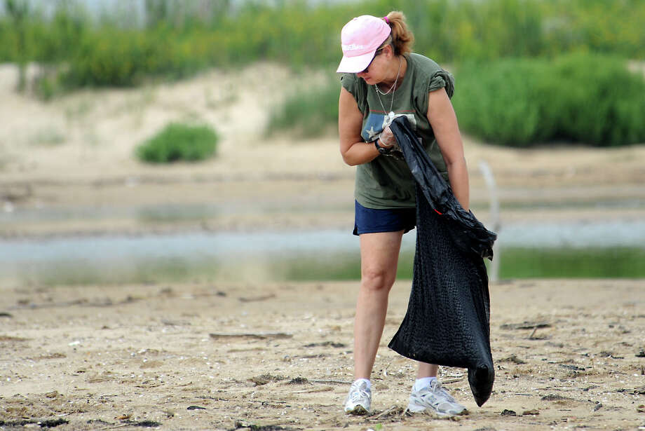 Nancy Dickey picks up trash during the Adopt-a-Beach clean up day at McFaddin Beach in September, 2009. Enterprise file photo Photo: TAMMY MCKINLEY / Beaumont