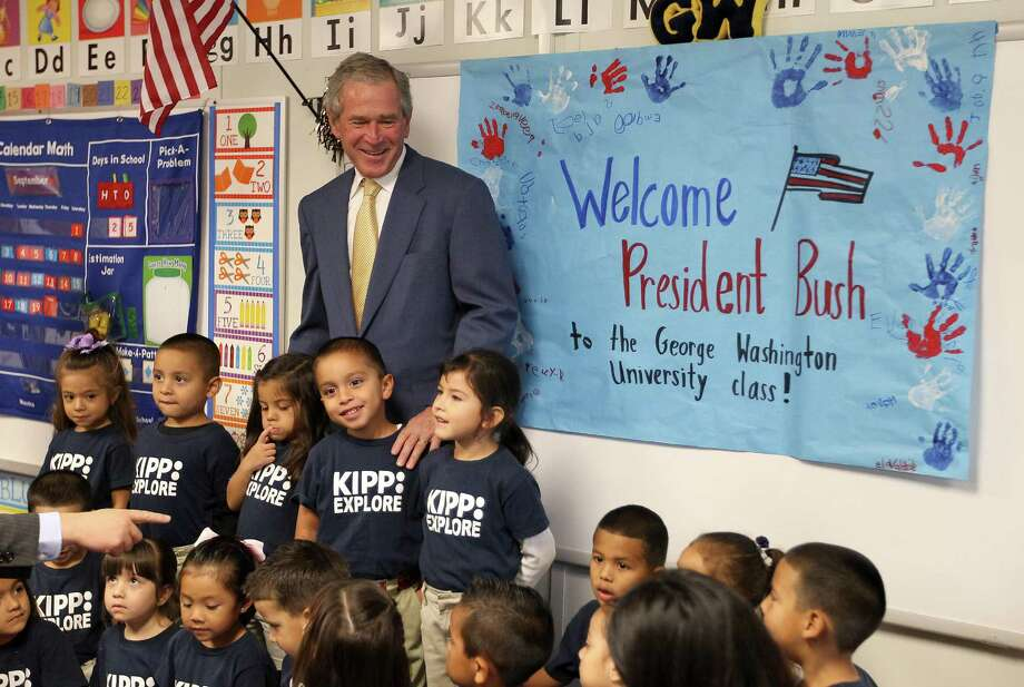 Former President George W. Bush stands out in the back row during a group photo Thursday in Mel Dreyer's pre-K class at KIPP Explore Academy before meeting HISD Superintendent Terry Grier and other leaders. Photo: Karen Warren / © 2012  Houston Chronicle