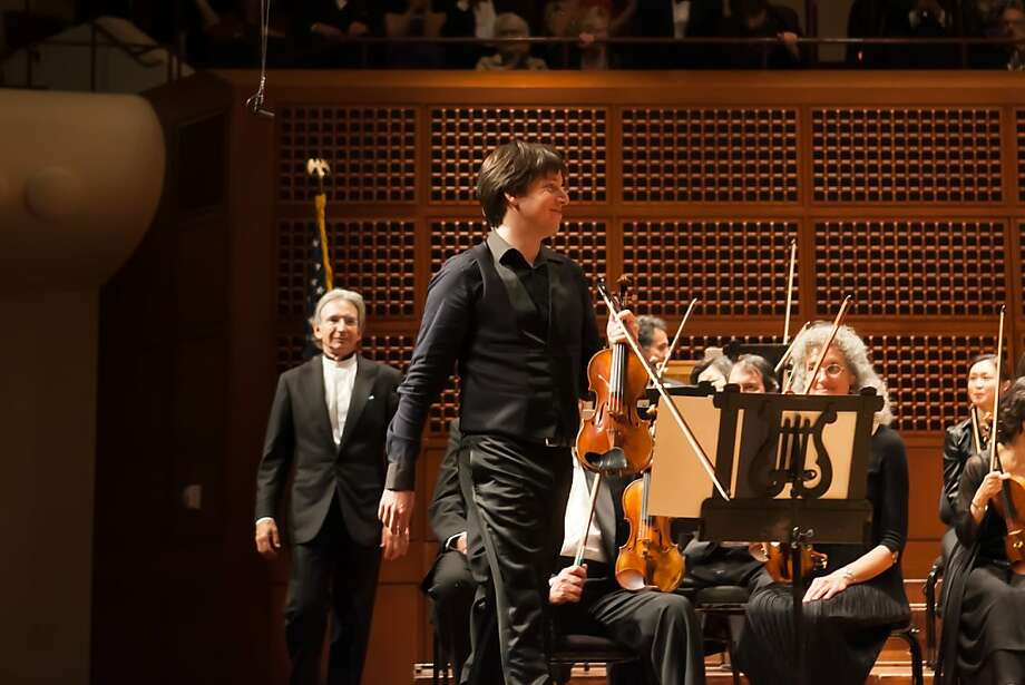 Violinist Joshua Bell and S.F. Symphony Music Director Michael Tilson Thomas take the stage for the orchestra's French-flavored season opener. Photo: Moanalani Jeffrey, SF Symphony