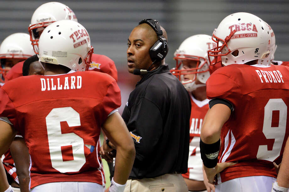 South all-star head coach Mike Jinks talks to his team during a time out during the 2012 Texas high school coaches association all-star football game on July 31, 2012 in the Alamodome in San Antonio Texas.