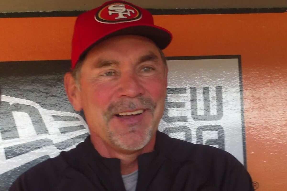 Giants skipper Bruce Bochy sports 49ers gear in support of quarterback Alex Smith.