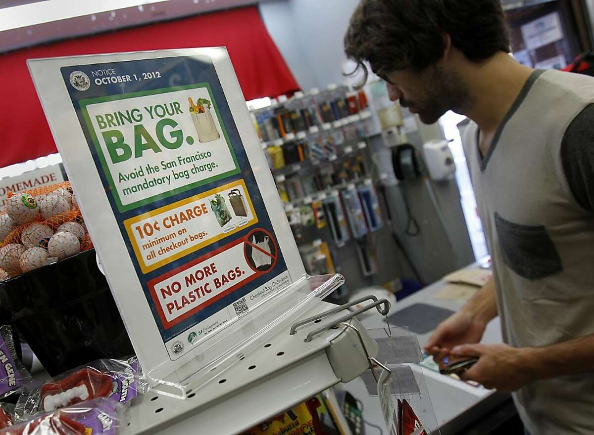 At Cole Hardware on Polk Street, large signs near cash registers announce the upcoming bag fee Thursday September 20, 2012. On October 1 San Francisco's bag ordinance goes into effect charging 10 cents if a customer wants a bag. Cole Hardware, a San Francisco institution, is ahead of the game posting signs announcing the change and doing away with plastic bags years ago.