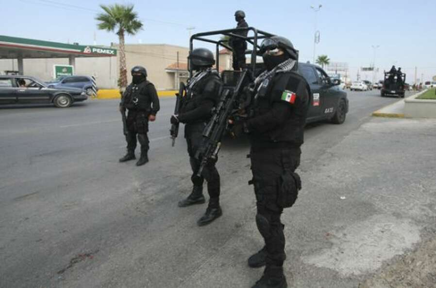 Rapid response Coahuila state police stand at a checkpoint in the city of Piedras Negras, Mexico, Tu