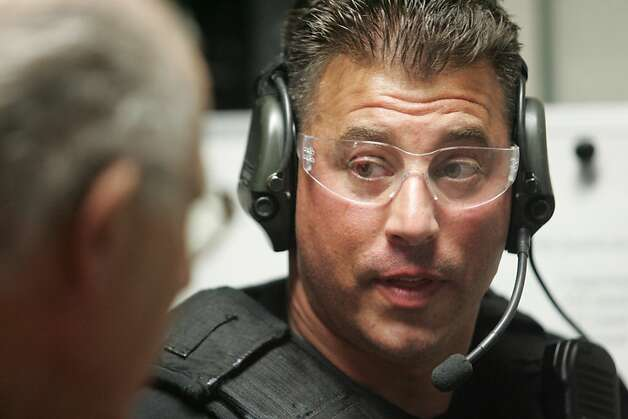 Fremont Police Officer Todd Young talks with firearms instructor Vince Mastracci during target practice in Fremont, Calif on Tuesday, Sept. 11, 2012. Young has returned to full-time work after being critically wounded while chasing a suspect in Oakland 2010. Photo: Mathew Sumner, Special To The Chronicle