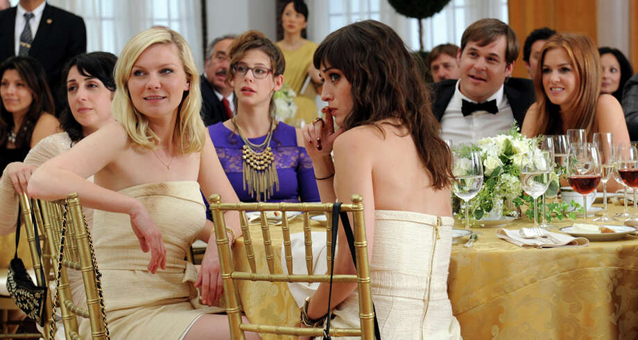 "An undated handout photo of Kirsten Dunst, left, and Lizzy Caplan in ""Bachelorette,"" a 2012 movie adaptation of the Off Broadway stage production. Comedy and musical stage performances can be hard to translate to a movie format because they feed off of audience reaction. (RADiUS-TWC via The New York Times) -- NO SALES; FOR EDITORIAL USE ONLY WITH STORY SLUGGED MUSICALS MOVIES BY CHARLES ISHERWOOD. ALL OTHER USE PROHIBITED. -- Photo: RADIUS-TWC / RADIUS-TWC"