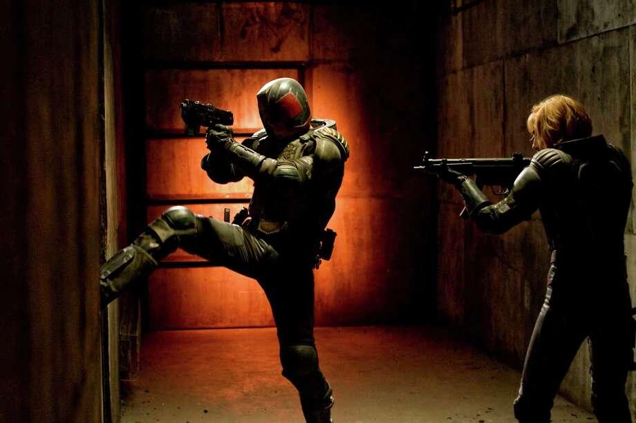 Joe Alblas/Lionsgate Entertainment Judge Dredd (Karl Urban) and Anderson (Olivia Thirlby) in DREDD 3D. Photo: Photo Credit: Joe Alblas