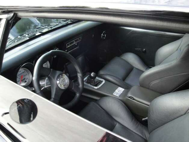 The clean interior features well-bolstered buckets and a custom three-spoke steering wheel.