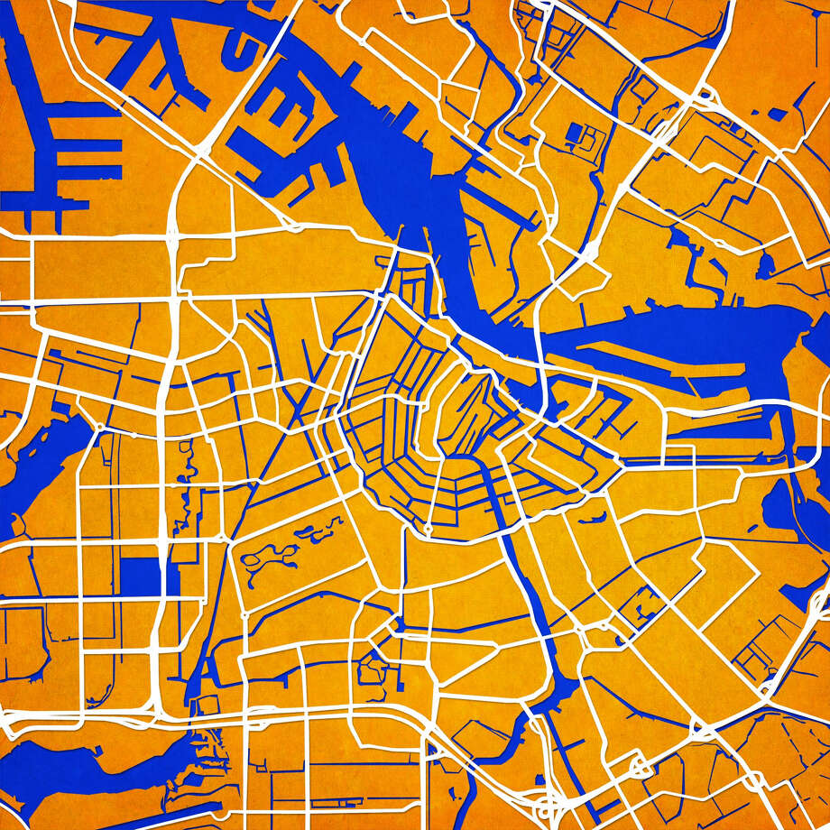 In this photo provided by City Prints, LLC, a map of Amsterdam is shown from Atlanta-based City Prints Map Art. In a GPS world, physical maps are becoming quaint relics for travelers. But decor with a map theme is hot. There's art in cartography: Street grids, the curve of a shoreline and topographic details offer visuals that lend themselves to wall art, rugs and textiles.  (AP Photo/City Prints, LLC)