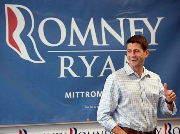 Republican vice presidential candidate, Rep. Paul Ryan, R-Wis., who will be in Darien on Sept. 30, gives a thumbs-up as he thanks northern Virginia campaign staff and volunteers for their work during a brief stop at  Republican campaign headquarters in Arlington, Va., Wednesday, Sept. 19, 2012. (AP Photo/Cliff Owen) Photo: Cliff Owen, Associated Press / FR170079 AP