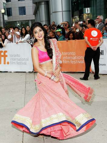 "TORONTO, ON - SEPTEMBER 09:  Actress Shriya Saran arrives at the ""Midnight's Children"" Premiere at the 2012 Toronto International Film Festival at Roy Thomson Hall on September 9, 2012 in Toronto, Canada.  (Photo by Jemal Countess/Getty Images) *** Local Caption *** Shriya Saran Photo: Jemal Countess / 2012 Getty Images"