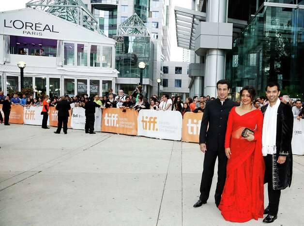 "TORONTO, ON - SEPTEMBER 09:  (L-R) Zaib Shaikh, Shahana Goswami, and Ronit Roy arrive at the ""Midnight's Children"" Premiere at the 2012 Toronto International Film Festival at Roy Thomson Hall on September 9, 2012 in Toronto, Canada.  (Photo by Jemal Countess/Getty Images) Photo: Jemal Countess / 2012 Getty Images"