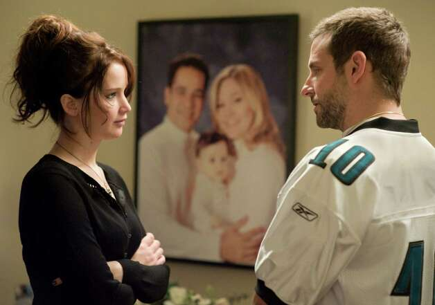 (L-R) JENNIFER LAWRENCE and BRADLEY COOPER star in SILVER LININGS PLAYBOOK Photo: JOJO WHILDEN / © 2012 The Weinstein Company.
