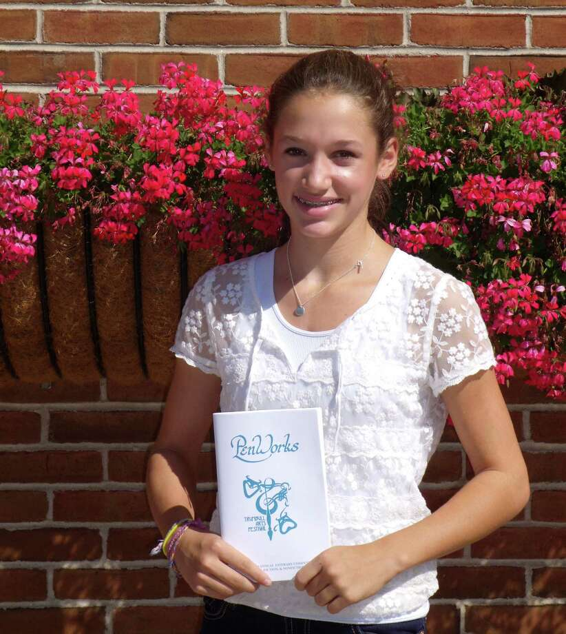 Emily Schussheim, an eighth-grade student at Coleytown Middle School, holds Pen Works, official publication of the 34th annual Trumbull Arts Festival Writing Contest. She won awards in the recent contest for two submissions. Photo: Contributed Photo