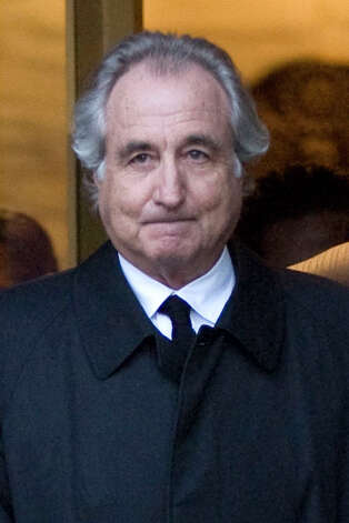 Bernard Madoff, president and founder of Bernard L. Mandoff Investment Securities LLC, walks out of Manhattan federal court in New York, U.S., on Monday, Jan. 5, 2009. Credit Suisse Group AG, whose clients lost almost $1 billion in Bernard Madoff's alleged swindle, urged customers more than eight years ago to withdraw cash from his firm because the bank couldn't determine how he made money, said three people familiar with the matter. Photographer: Jin Lee/Bloomberg News Photo: JIN LEE, BLOOMBERG NEWS