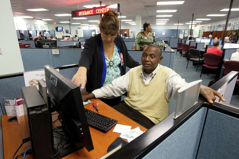 WorkForce One staff member Rose Capote-Marcus works with client Pen Osuji as he fills out job applications in Hollywood, Fla. One new approach to references is to shift the responsibility of collecting them to the applicants. Photo: J Pat Carter / AP