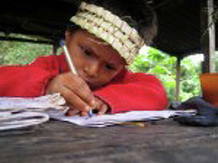 A young student does homework in the Wishi community of Ecuador, made possible by support from The Wishi Project and the World Soccer Project. (http://wishi.org/)