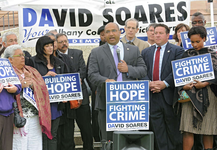 Incumbent District Attorney David Soares announces his plans to seek a third 4-year term Monday, June 4, 2012 in Academy Park in Albany, N.Y. Albany County Democratic Chairman Matthew Clyne (back row to right of Soares) announced his endorsement of Soares today. (Lori Van Buren / Times Union)
