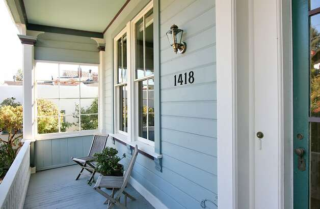 The front porch of the main Victorian home provides an exceptional location for relaxing on a cool autumn afternoon or enjoying time with family in the evening. Photo: Liz Rusby