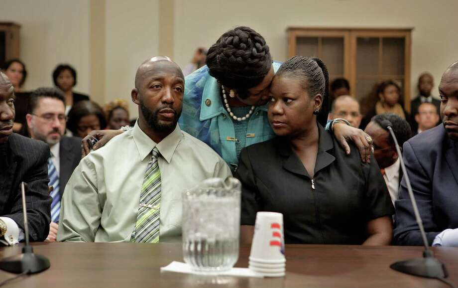 Rep. Sheila Jackson-Lee embraces Sybrina Fulton and Tracy Martin, the parents of Trayvon Martin, during a House Judiciary Committee briefing on March 27, 2012. Photo: Chip Somodevilla, Getty Images / 2012 Getty Images