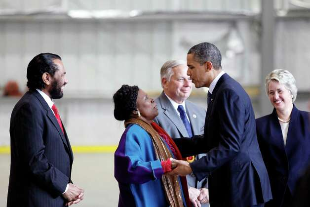 President Barack Obama greets Sheila Jackson Lee, shortly after arriving on Air Force One on March 9, 2012, at Ellington Airport in Houston. Photo: TODD SPOTH, For The Chronicle / Todd Spoth