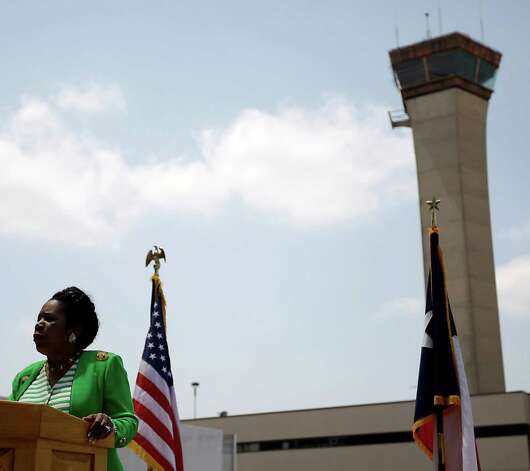 Sheila Jackson Lee speaks to the media at Bush Intercontinental Airport on April 19, 2011, about her bill to require additional staffing for air traffic controllers. Photo: Karen Warren, Houston Chronicle / Houston Chronicle