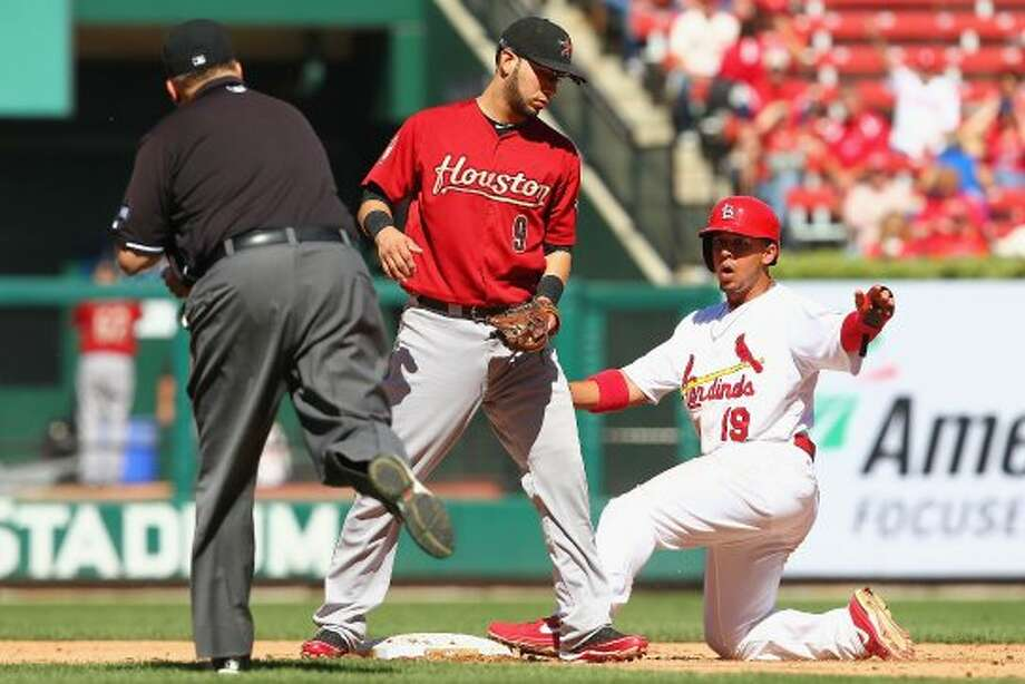Jon Jay looks to the umpire for a call after being thrown out trying to steal second base against Marwin Gonzalez. (Dilip Vishwanat / Getty Images)