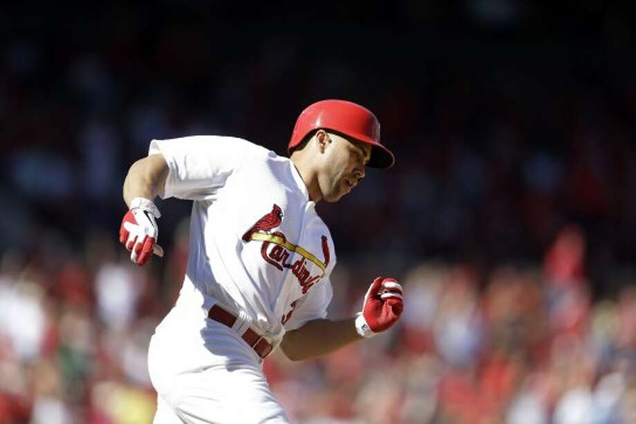 Carlos Beltran rounds first on a two-run double during the sixth inning. (Jeff Roberson / Associated Press)