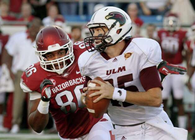 Arkansas defensive end Trey Flowers (86) pressures Louisiana Monroe quarterback Kolton Browning (15) during the first quarter of an NCAA college football game in Little Rock, Ark., Saturday, Sept. 8, 2012. (AP Photo/Danny Johnston) Photo: Daniel Johnston, Associated Press / AP