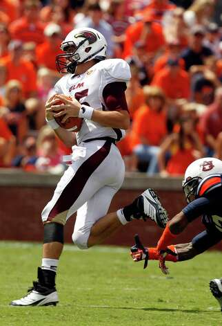 Louisiana-Monroe quarterback Kolton Browning (15) gets past the grasps of Auburn defensive back Demetruce McNeal (12) for a touchdown during the first half of an NCAA college football game on Saturday, Sept. 15, 2012, in Auburn, Ala.  (AP Photo/Butch Dill) Photo: Butch Dill, Associated Press / FR111446 AP