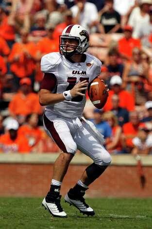 Louisiana-Monroe quarterback Kolton Browning (15) looks to pass against Auburn during the second half of an NCAA college football game on Saturday, Sept. 15, 2012, in Auburn, Ala.  (AP Photo/Butch Dill) Photo: Butch Dill, Associated Press / FR111446 AP
