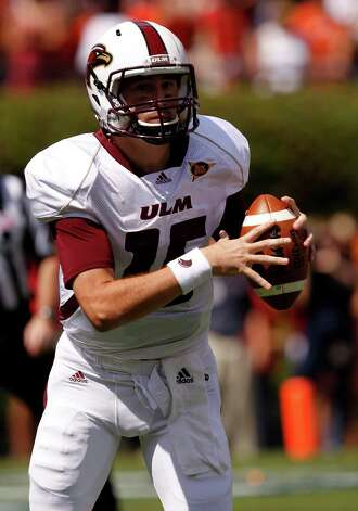 Louisiana-Monroe quarterback Kolton Browning (15) rolls out to pass during the first half of an NCAA college football game against Auburn on Saturday, Sept. 15, 2012, in Auburn, Ala.  (AP Photo/Butch Dill) Photo: Butch Dill, Associated Press / FR111446 AP