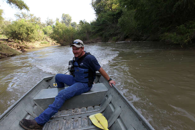 San Antonio River Authority's Chris Svoboda cruises down the San Antonio River along the Saspamco Paddling Trail in Southern Bexar County that is overseen by the San Antonio River Authority (SARA) on Thursday, Sept. 20, 2012. The paddling trail is now open for public use and snakes along a 12-mile stretch of the San Antonio River. In two weeks, SARA will host a public opening event at the Helton San Antonio Nature Park which is situated at the end of the paddling trail in Wilson County. The start of the paddling trail is about 20 miles from downtown San Antonio. Photo: Kin Man Hui, San Antonio Express-News / ©2012 San Antonio Express-News