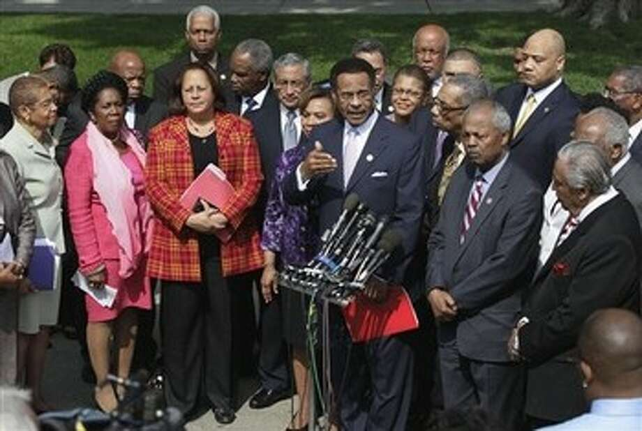 Congressional Black Caucus Chairman Rep. Emanuel Cleaver II,  D-Mo., center, accompanied by fellow CBC members, speaks outside the White House in Washington, Thursday, May 12, 2011, following their meeting with President Barack Obama. From left are, Del. Eleanor Holmes Norton, D-D.C., Rep. Sheila Jackson Lee, D-Texas, Rep. Laura Richardson, D-Calif., Rep. Bobby Scott, D-Va., Rep. Barbara Lee, D-Calif.,  Cleaver, Rep. Bobby Rush, D-Ill., Rep. Donald Payne, D-N.J., and Rep. Charles Rangel, D-N.Y. Photo: Carolyn Kaster, AP / AP