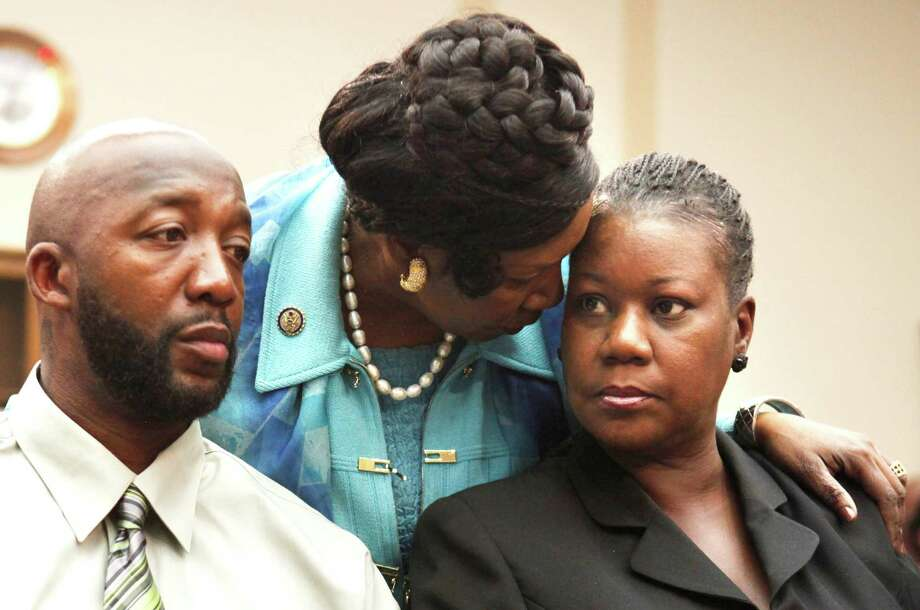 Rep. Sheila Jackson Lee greets Trayvon Martin's parents, Tracy Martin and Sybrina Fulton, during a House Judiciary Committee briefing on racial profiling and hate crimes on March 27, 2012. Photo: Jacquelyn Martin, Associated Press / AP