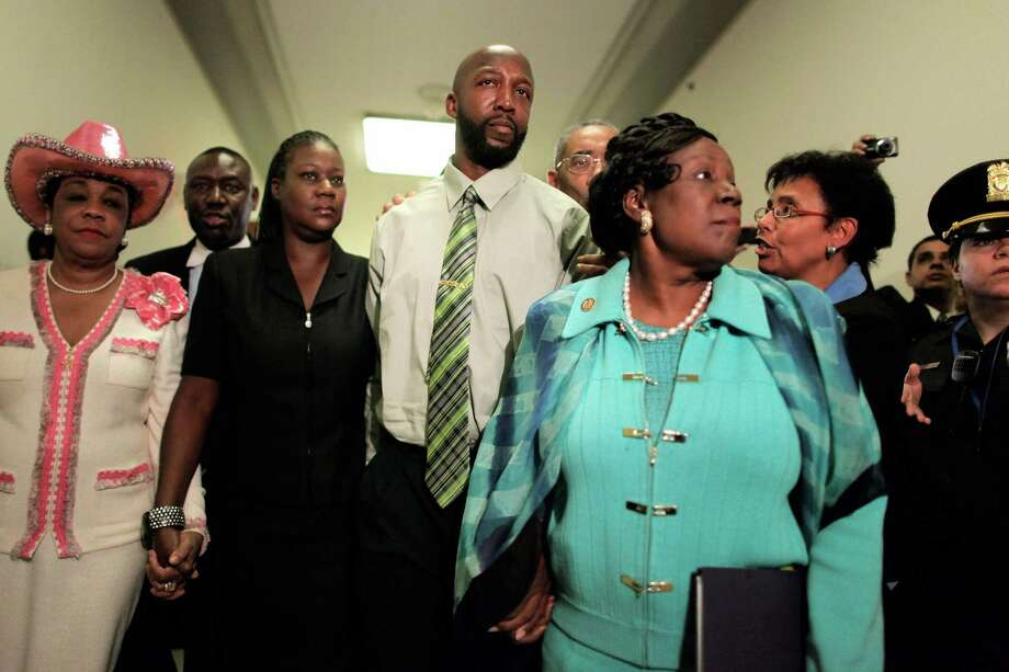 The parents of Trayvon Martin, Tracy Martin and Sybrina Fulton, are escorted by Rep. Frederica Wilson, D-Fla., attorney Benjamin Crump, Rep. Bobby Rush, R-Ill. and Rep. Sheila Jackson-Lee after attending a House Judiciary Committee hearing in Washington, D.C. Photo: Chip Somodevilla, Getty Images / 2012 Getty Images