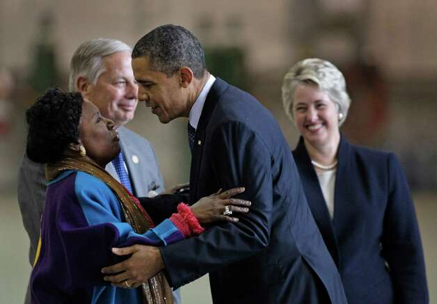Congresswoman Shelia Jackson Lee hugs President Barack Obama as she greets him at Ellington Field on March 9, 2012, in Houston. Photo: Melissa Phillip, Houston Chronicle / © 2012 Houston Chronicle